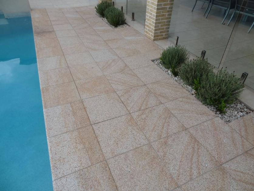 Light Yellow granite exfoliated coping tiles from J.H. Wagner & Sons.